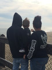 Tifeni and Roy Monn point out Jet Skiers to 2-year-old Oakly on Sunday Dec. 13, in Ocean City.