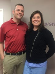 Dr. Joanna Santiesteban, an obstetrician/gynecologist in Prestonsburg, stands with her husband, Brent Graden, general manager of their practice, Harper OB/GYN.