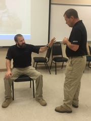 Dave Young and Mike Delvaux of Vistelar teach law enforcement
