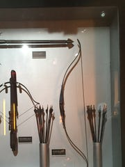 Bows and arrows and crossbows from the films are on