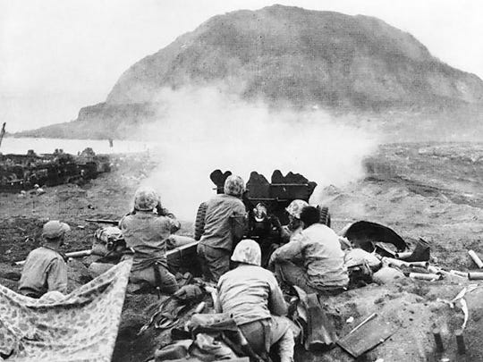 Rounds from a 37mm gun try to reach cave positions on Iwo Jima.