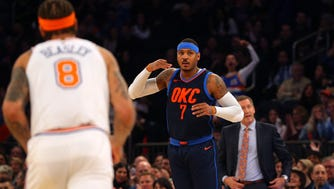 Oklahoma City Thunder power forward Carmelo Anthony (7) reacts after a three point shot against the New York Knicks during the first quarter at Madison Square Garden on Saturday, Dec. 16, 2017.