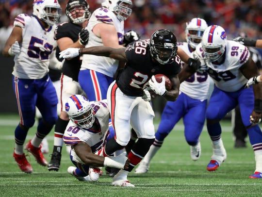 Atlanta Falcons running back Tevin Coleman (26) runs
