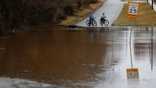 Water covers the road on East Rockaway Street on Saturday, February 24.