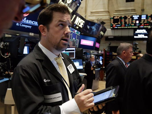 Gains go poof: Dow turns red near close, loses 205