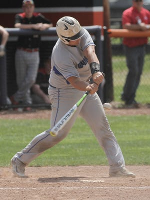 Wynford's Caleb Stone swings at the bat during a playoffs game against New London at Galion High School on Wednesday afternoon.