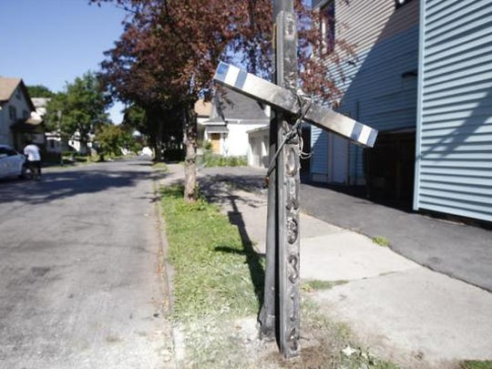 The damaged Daryl Pierson memorial near the corner of Hudson Avenue and Warsaw Street as it looked on July 22.
