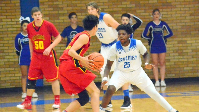 Carlsbad's Shamar Smith looks to get a stop against Centennial's Wilson Bannister during Friday's District 3-6A game. The Cavemen are getting back on track on defense, giving up just 48 points a game in their last six games.