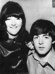 Freda Kelly poses with Paul McCartney at the Cavern Club, where the band got its start in Liverpool.
