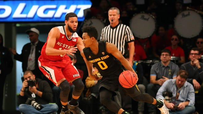 Nov 23, 2015: Arizona State Sun Devils guard Tra Holder (0) drives past North Carolina State Wolfpack guard Cody Martin (15) during the first half at Barclays Center.