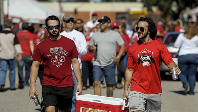 UL fans tailgate prior to the NCAA football game against Georgia State University at Cajun Field in Lafayette, La., Saturday, Oct. 4, 2014. Paul Kieu, The Advertiser