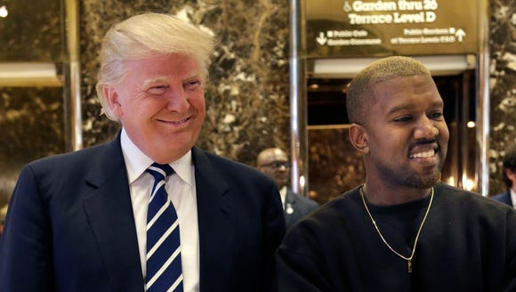 President Trump and Kanye West pose for a picture in