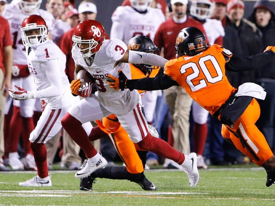 Oklahoma wide receiver Sterling Shepard takes off against Oklahoma State. He could be a second-round target of the Bengals.