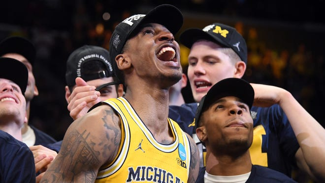 Mar 24, 2018; Los Angeles, CA, USA; Michigan Wolverines guard Charles Matthews (1) celebrates with teammates after the Michigan Wolverines defeated the Florida State Seminoles in the championship game of the West regional of the 2018 NCAA Tournament at STAPLES Center.