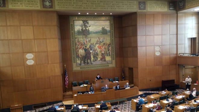 Lawmakers in Oregon's House of Representatives sit in session in Salem, Ore., Wednesday, April 26, 2017.