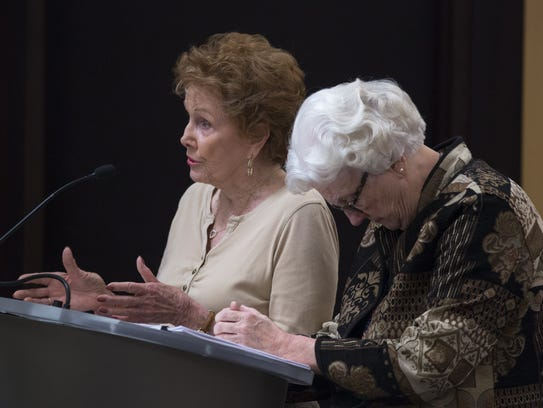 Maricopa County Recorder Helen Purcell (left) answers