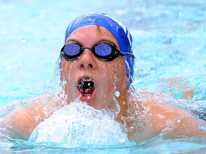 Bluegrass swimmer Andrew Crockett swims the breaststroke and led during the boys 13- to 14-year-old 100-yard individual medley during the  swim meet Thursday between Bluegrass Yacht and Country Cub and Cages Bend Swim Club.