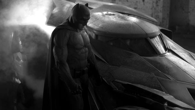 Ben Affleck as Batman stands next to the Batmobile in this photo tweeted by director Zack Snyder. It is the first shot of Affleck in the costume, which appears to be inspired by Frank Miller's graphic novel, The Dark Knight Returns.