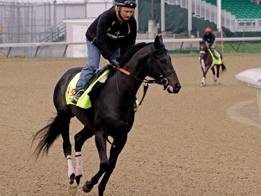 Exercise rider Issac Muniz takes Kentucky Derby hopeful Dance With Fate for a morning workout at Churchill Downs Wednesday, April 30, 2014, in Louisville, Ky. (AP Photo/Garry Jones)