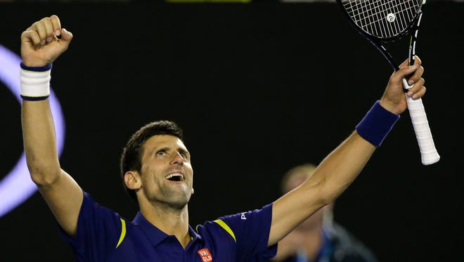 Novak Djokovic of Serbia celebrates after defeating Andy Murray of Britain in the men's singles final at the Australian Open tennis championships in Melbourne, Australia, on Saturday