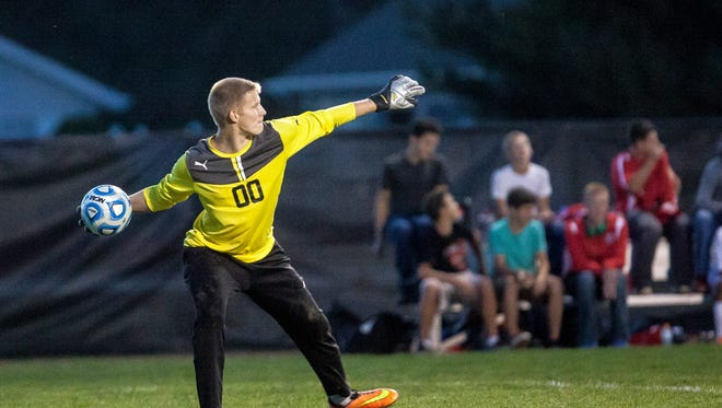 Jay County's goalie Trevor Moeller throws the ball to his team after another successful block against Central Wednesday at the Yorktown Sports Complex. Jay County won 2-1.
