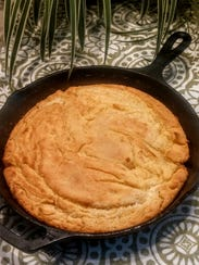 Homemade cornbread cooked on an iron skillet.
