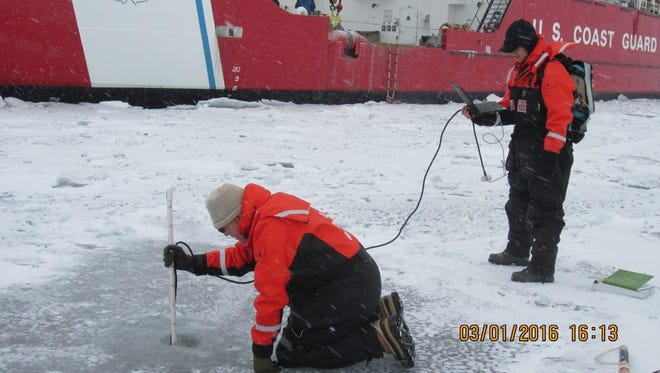 George Leshkevich and Sam Aden on the ice conducting tests for NOAA research.