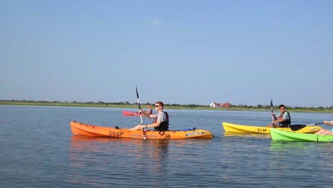 Kayakers paddle at Delaware Seashore State Park.