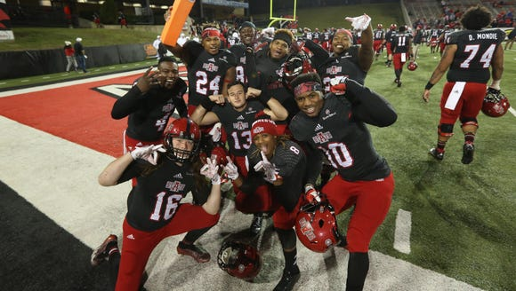 Arkansas State Red Wolves players celebrate after the