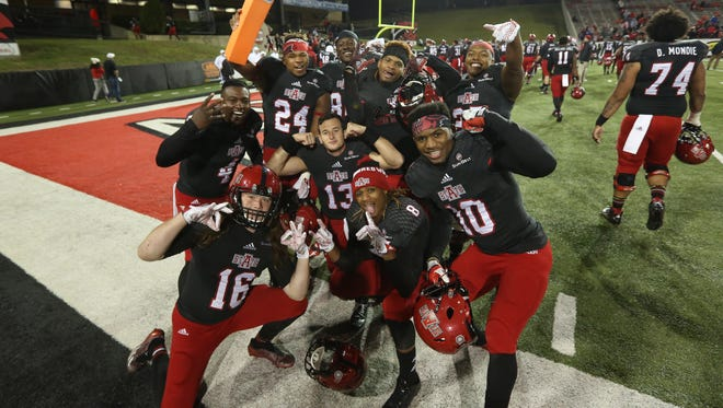 Arkansas State Red Wolves players celebrate after the game against the Idaho Vandals at Centennial Bank Stadium. Arkansas State defeated Idaho 49-35. Mandatory Credit: Nelson Chenault-USA TODAY Sports