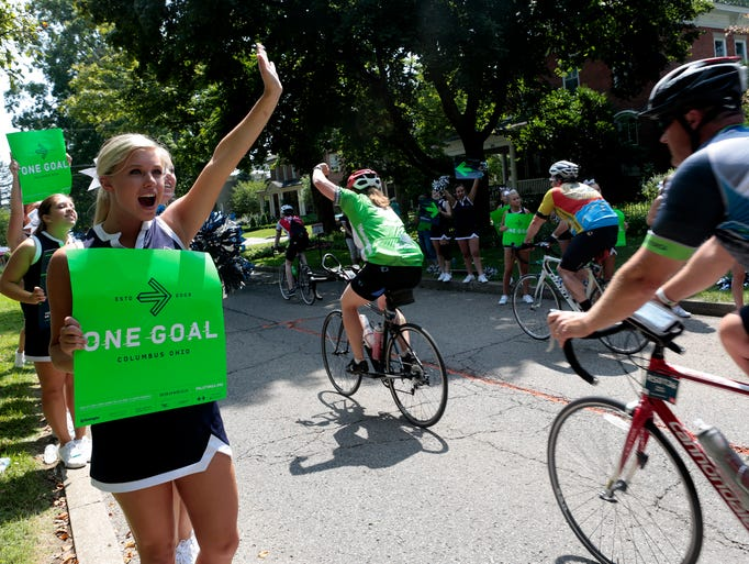 Lexi Kunar and other Granville High School and Middle School cheerleaders cheer on Pelotonia cyclists  as they pedal their way through Granville.
