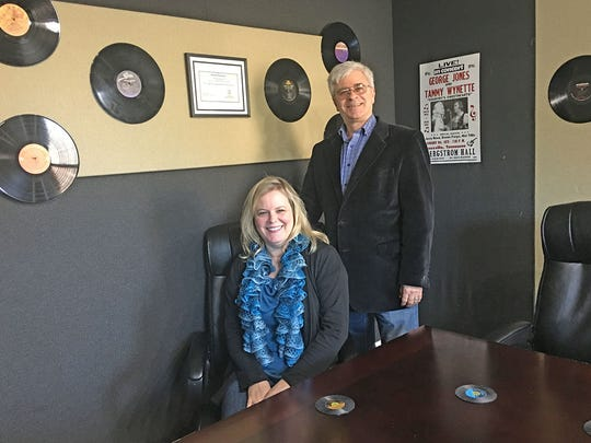 Rick and Amy DeBusk in their EXIT Realty Music Row conference room, which remains original from the recording times.