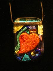 Marie Rasmussen features her dichroic glass beads at the Christmas Boutique.