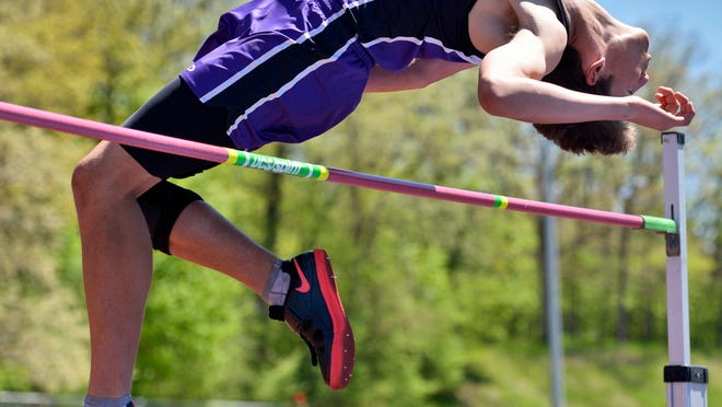 <238><145,9><238,1>RIGHT: <239>St. Cloud Christian School's David Verwijs clears the bar at 5-feet-7 inches in the boys high jump at the Section 5A track meet Wednesday at St. John's University.