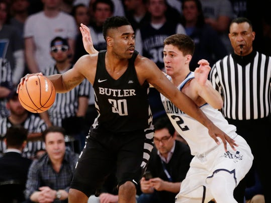 Villanova's Collin Gillespie (2) defends Butler's Kelan Martin (30) during the first half of an NCAA college basketball game in the Big East men's tournament semifinals Friday, March 9, 2018, in New York. (AP Photo/Frank Franklin II)
