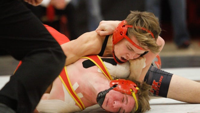 Foothill's Dalton Lackmann, top, gains on Chico High's Ryan Rudkin during the 154-pound bout of the wrestling dual Wednesday at Chico High School. Lakmann won a 7-2 decision.