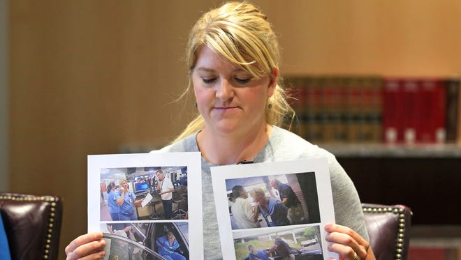 In this Friday, Sept. 1, 2017, file photo, nurse Alex Wubbels displays video frame grabs from Salt Lake City Police Department body cams of herself being taken into custody, during an interview in Salt Lake City.