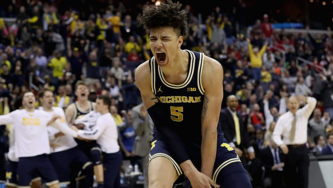 D.J. Wilson, who now plays for the Bucks, celebrates during Michigan's run to the Sweet 16 in the NCAA Tournament last year.