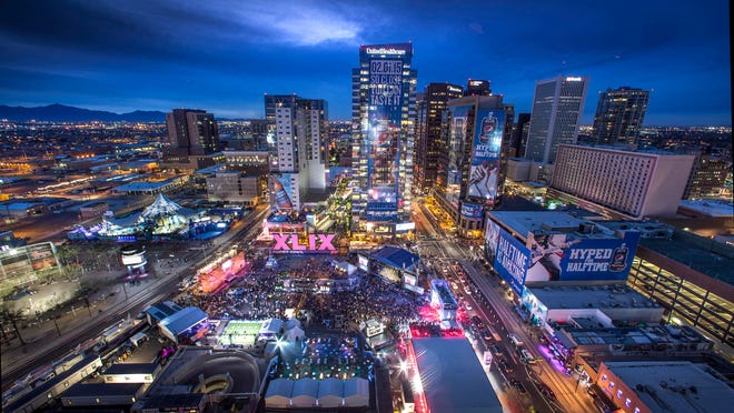 Verizon Super Bowl Central offers 12 blocks of free concerts and NFL-related activities in downtown Phoenix.David Kadlubowski/The Republic