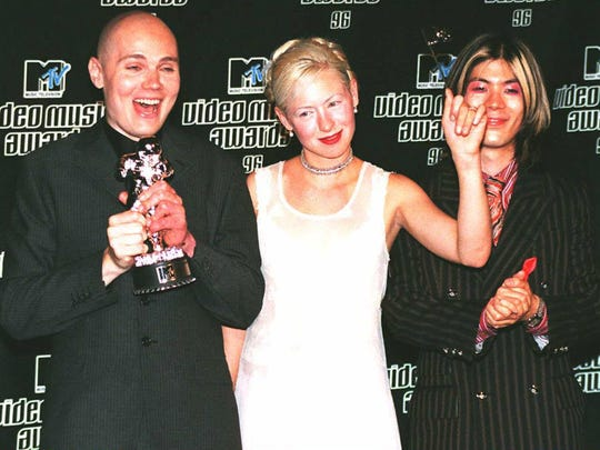The Smashing Pumpkins pose with their award for Best Video of the Year in 1996 at the MTV Video Music Awards at Radio City Music Hall in New York City.