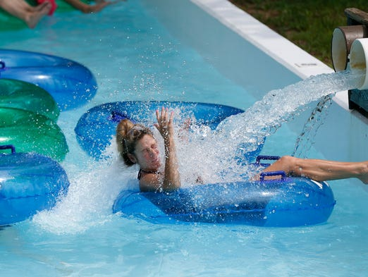 Kristin King of Mason gets a face full of water while cruising the Kokomo Lazy River at The Beach Waterpark, July 20, 2013.