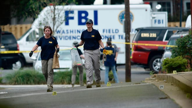Member of the FBI inspect the crime scene after a shooting during a practice of the Republican congressional baseball at Eugene Simpson Statium Park Wednesday in Alexandria, Virginia.