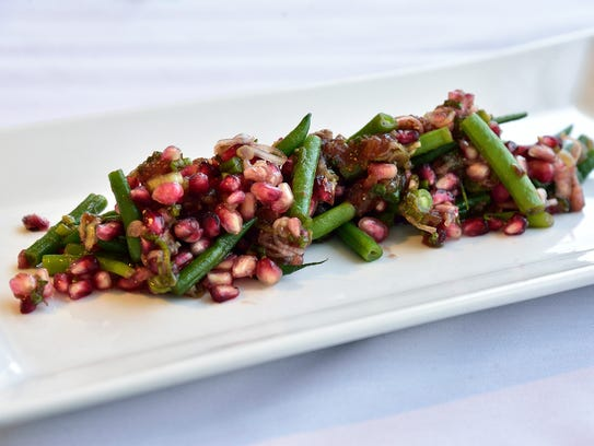 Pomegranate, green beans, dates, honey, honeycomb,
