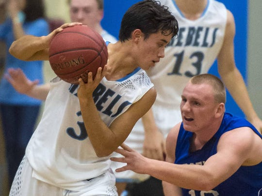 South Burlington's Ben Moran, left, is pressured by