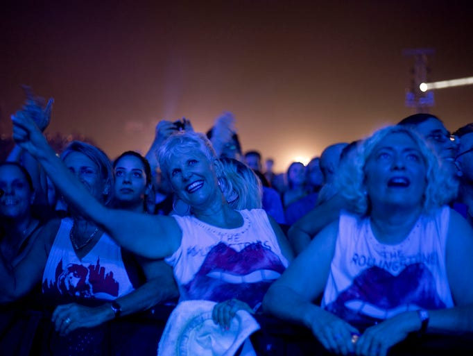 Spectators watch the Rolling Stones concert in Hayrkon Park in Tel Aviv, Israel, Wednesday June 4, 2014. (AP Photo/Ariel Schalit)