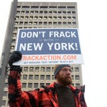 Windsor resident Joseph Sopata holds a sign up in front of the State Office Building in downtown Binghamton in support of the large-scale fracking ban that New York State Governor Andrew Cuomo said he will put in place after the state's environmental and health commissioners recommended it.