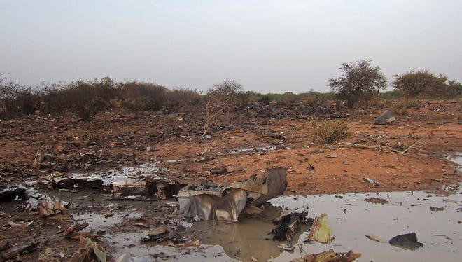 This photo provided on Friday, July 25, 2014,  by the Burkina Faso Military shows the site of the plane crash in Mali. French soldiers secured a black box from the Air Algerie wreckage site in a desolate region of restive northern Mali on Friday, the French president said. Terrorism hasn't been ruled out as a cause, although officials say the most likely reason for the catastrophe that killed all onboard is bad weather. At least 116 people were killed in Thursday's disaster, nearly half of whom were French.