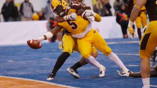 Central Michigan running back Jonathan Ward (5) reaches for the goal line   during the second half of the Famous Idaho Potato Bowl on Friday, Dec. 22, 2017, in Boise, Idaho.