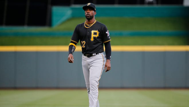 Pittsburgh Pirates right fielder Andrew McCutchen (22) warms up before the National League Central baseball game between the Pittsburgh Pirates and the Cincinnati Reds, Tuesday, May 2, 2017, at Great American Ball Park in Cincinnati.