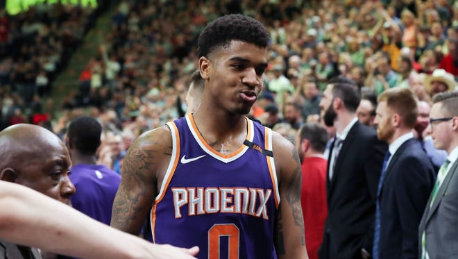 Mar 15, 2018; Salt Lake City, UT, USA; Phoenix Suns forward Marquese Chriss (0) walks off of the court after being ejected for fighting during the second half against the Utah Jazz at Vivint Smart Home Arena. Utah Jazz won 116-88. Mandatory Credit: Chris Nicoll-USA TODAY Sports